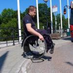 Go down a curb in a wheelchair