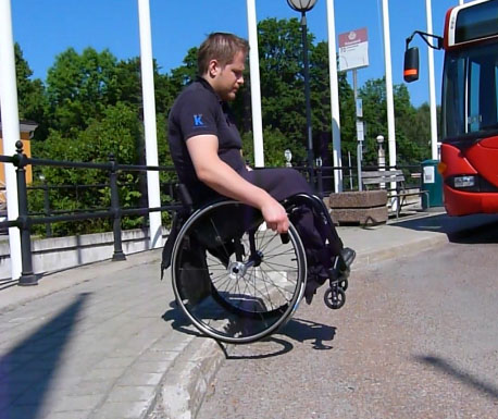 Go down a curb in a wheelchair