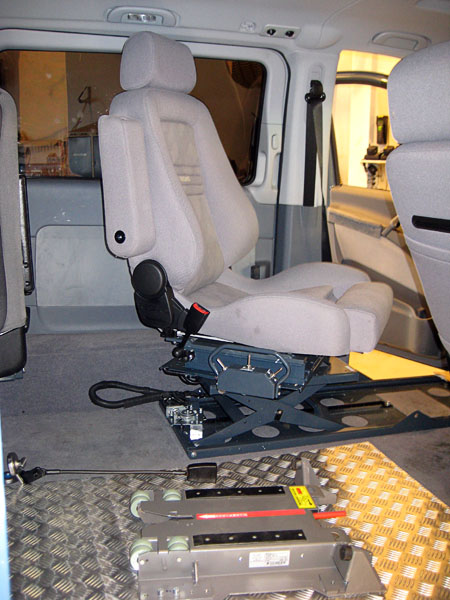 Driver's seat moved backward; foreground shows anchor for wheelchair