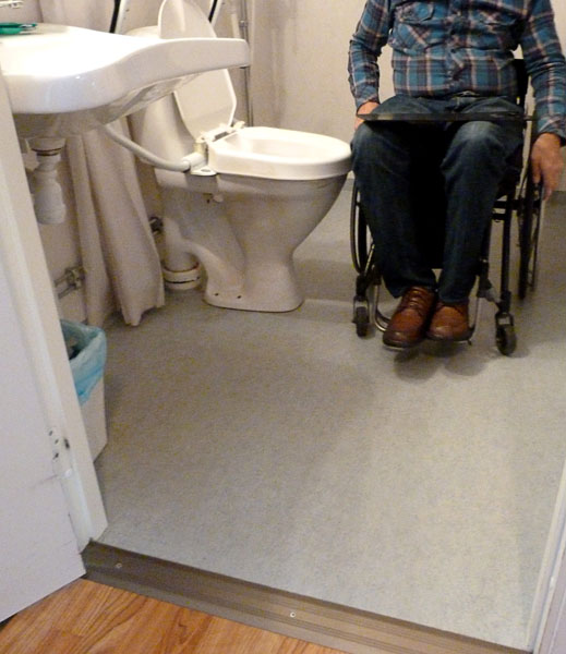 User next to toilet