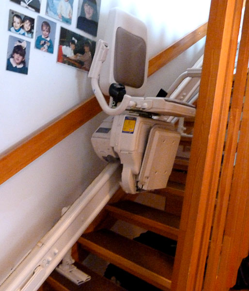 Stairlift with chair, footrest raised