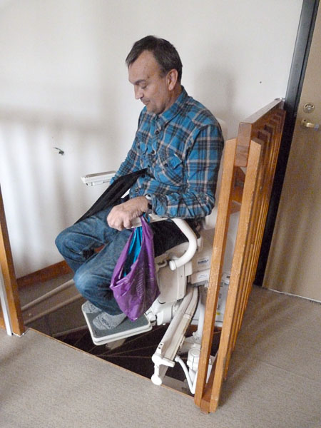 User on stairlift