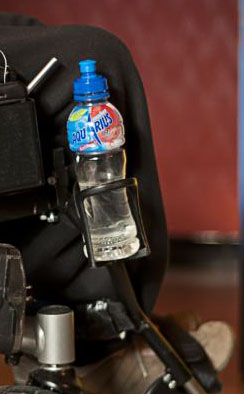 Holder for water bottle on wheelchair