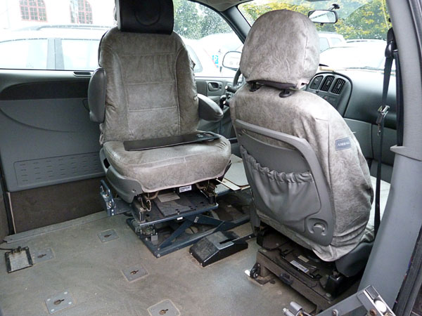Electrically adjustable driver's seat in modified car