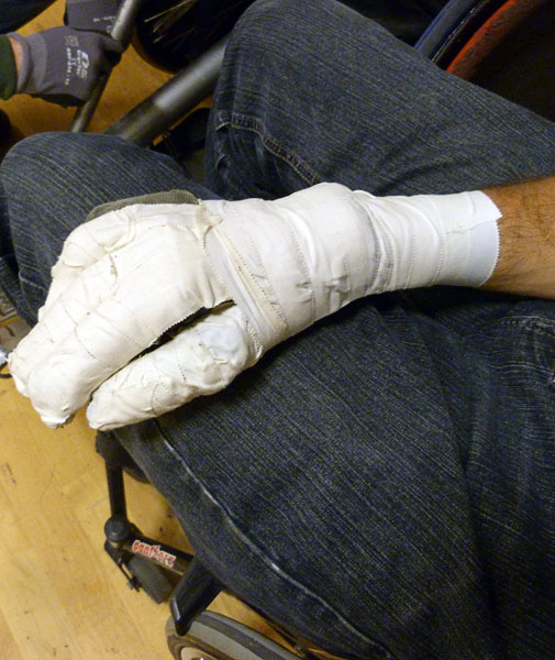 Leather glove taped with sports tape (palm)