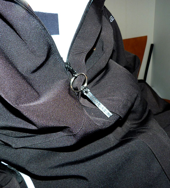 Modified zipper with key ring and tab.