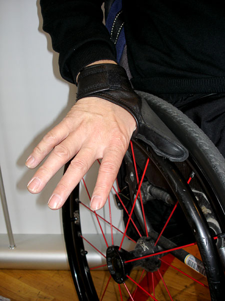 Custom-made wheelchair gloves