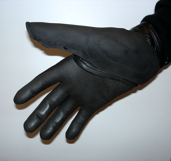 User with specially-sewn wheelchair glove, with liner glove