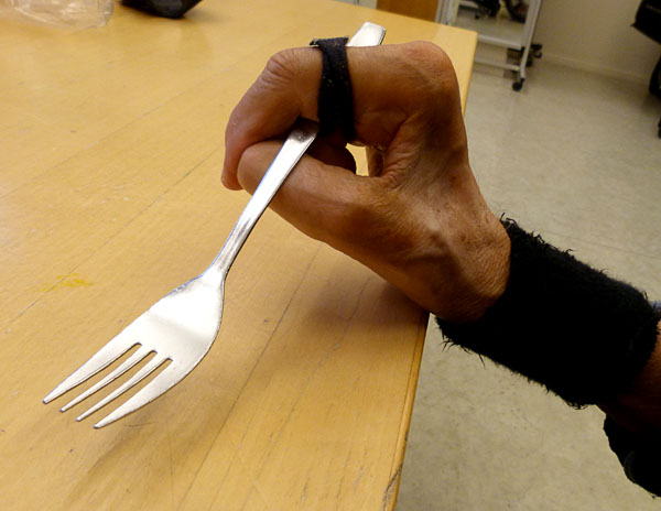 User with purchased strap used as a flatware strap