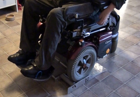 The user cleans his wheelchair tires