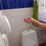 Flush toilet using a string