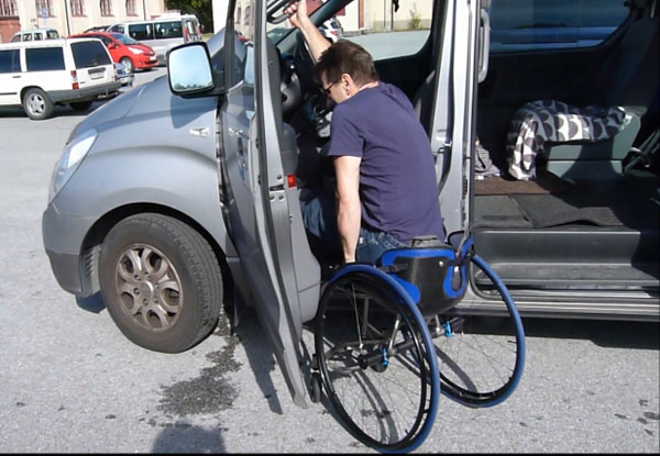 Transfer from wheelchair to a minivan