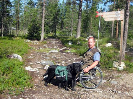 User with his dog in the forest. Photo: from the user's archives
