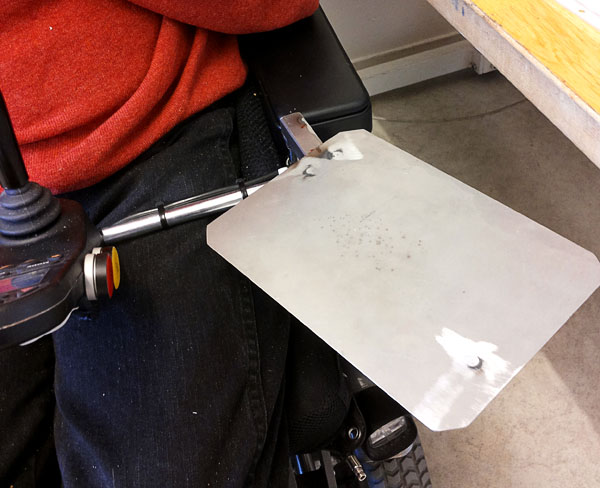 IPad-holder in wheelchair attachment device