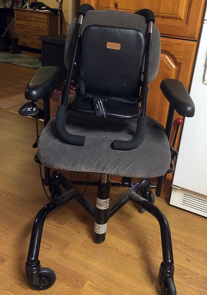 Trille highchair mounted on a chair with casters