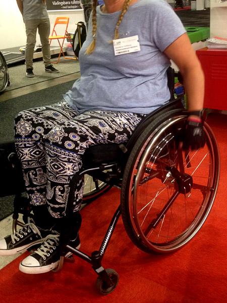 Växlingsbara rullstolshjul med backspärr
