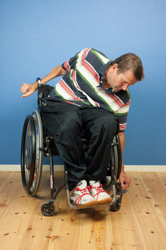 Lägesändra i rullstol: luta åt ena sidan